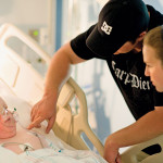 Katie and Eddie Wood check on their son, Reid Wilson, in the PICU.