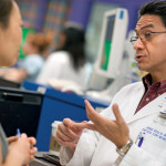 Attending PICU physician Dr. Jorge Coss Bu consults with Texas Children's Cancer Center physician Dr. Kathryn Leung.