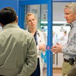 Pediatric neurology specialist Dr. Angus Wilfong (second from right) consults on a case.
