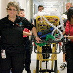 Kangaroo Crew personnel transport a new patient into the PICU.