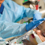 A nurse tends to PICU patient Hecto Melecio. With more than 60 critical care nurses and 21 nurse practitioners and physician assistants on staff in critical care, Texas Children's PICU is one of the safest in the nation, having achieved a remarkable 310 days without a central line infection.