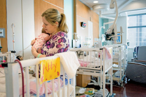 Martin checks in on 7-week-old Abby, who shares a state-of-the-art private room at the neonatal intensive care unit in Texas Children's Pavilion for Women.