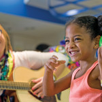 Playing a tambourine takes concentration, mobility and interest. Music therapist Amy Smith's visits with Victoria Fields include individual music time and group lessons.
