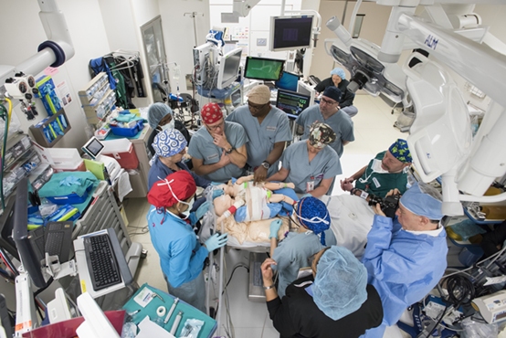 Lead surgeons Darrell Cass, MD, and Oluyinka Olutoye, MD, and lead anesthesiologist Helena Hippard-Karlbeg, MD, participate in a lengthy simulation prior to the marathon separation of conjoined twins Knatalye and Adeline Mata.