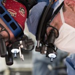Two of several surgeons who performed the separation of the Mata twins work intently during the complex procedure.